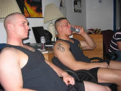 Two cute muscled soldiers relaxing in tank tops