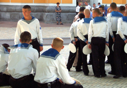 Group of cute young navy sailors in white uniform