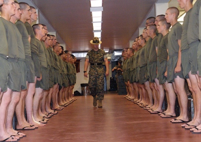 Drill instructor inspecting of dorm during boot camp