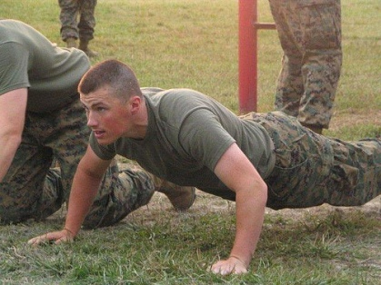Muscular soldier in uniform doing push-ups